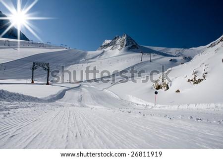 Ski slope under high mountains. Kaprun, Austria. - stock photo