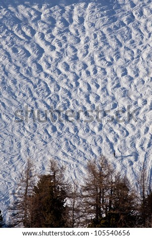 Ski slope with snowy bumps