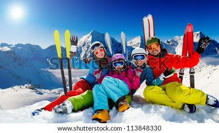 Ski, snow, sun and winter fun -  happy family ski team