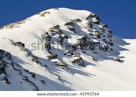 ski track on mountain peak