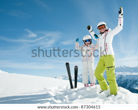 Ski vacation - portrait of happy skiers