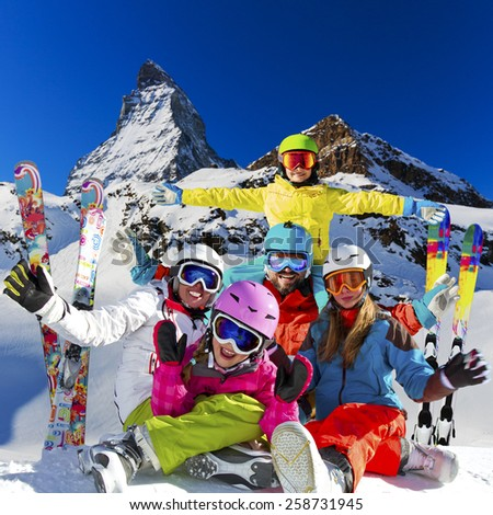 Ski, winter, snow - family enjoying winter vacation in Zermatt, photo manipulation: Only four model releases are needed - the same child on the photo. - Shutterstock ID 258731945
