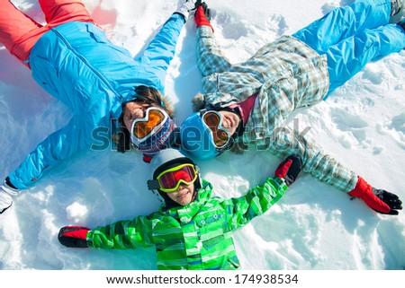 Ski, winter, snow, skiers, sun and fun - family enjoying winter vacations.