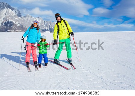 Ski, winter, snow, skiers, sun and fun - family enjoying winter vacations.