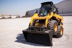 Skid loader or bobcat standing up position