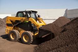 Skid loader or bobcat working on Manganese in Bulk