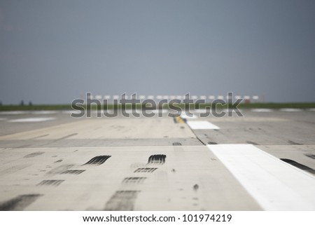 Skid marks on at the airport runway - selective focus