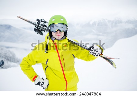 Skier carrying skis