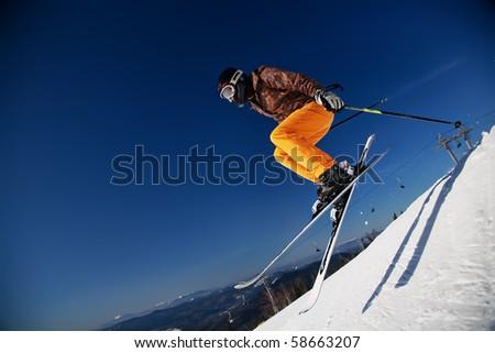 Skier girl jumping over blue sky