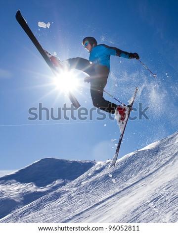 skier in a jump in backlight