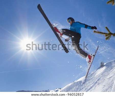 skier in a jump in backlight
