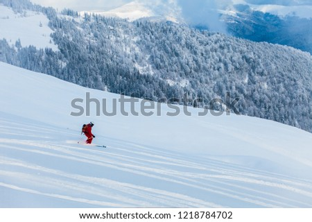 Skier in beautiful resort #1218784702