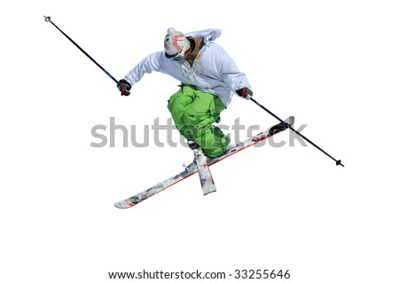 skier in green and white clothes performing a tele-heli with skis crossed at the same time as executing a full spin (in this shot, facing backwards) isolated against a white background