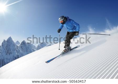 Skier in high mountains - alpine
