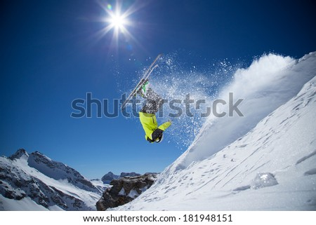 Skier in high mountains during sunny day. #181948151