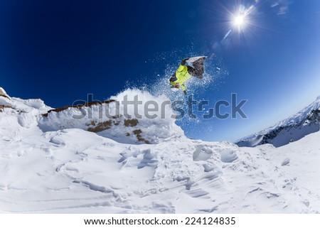 Skier in high mountains during sunny day. #224124835