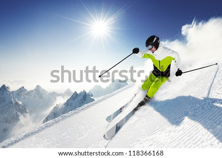 Skier in mountains, prepared piste and sunny day #118366168