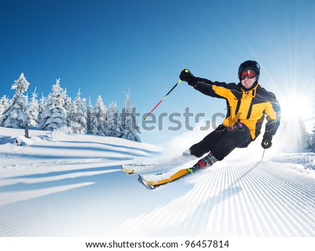 Skier in mountains, prepared piste and sunny day #96457814