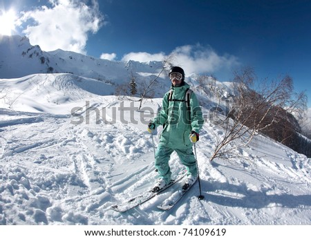 Skier in the mountains at Krasnaya Polyana. Sochi - capital of Winter Olympic Games 2014. Russia.