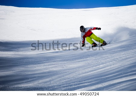 Skier in the snow  powder skiing fast