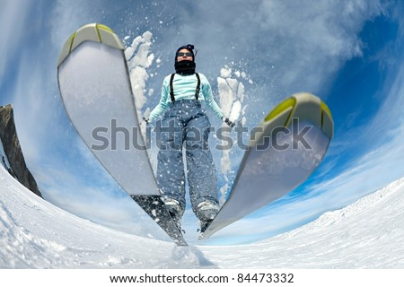 Skier jumping on the slope