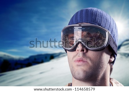 skier looking at the mountains with snowy mountains in the background. #114658579
