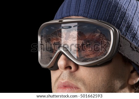 skier looking for a snowy mountain on a black background. #501662593