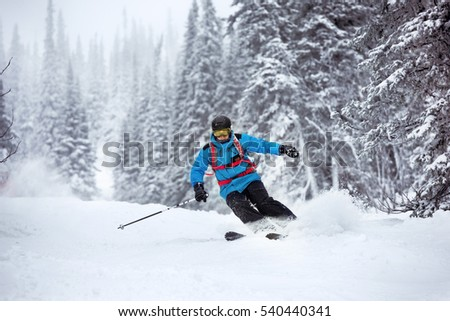 Skier moving very fast in forest. Off-piste slope in Sheregesh ski resort #540440341