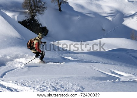 Skier on a slope in powder snow