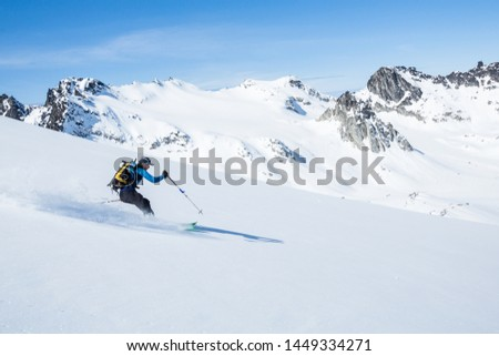 Skier on sunny day and fresh snow ripping down the slope above the Snowbird Glacier in Hatcher Pass, Alaska. Stock fotó ©