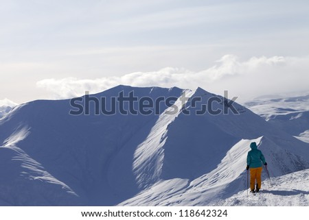 Skier on top of mountain. Caucasus Mountains, Georgia, ski resort Gudauri.