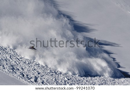 Skier riding the avalanche