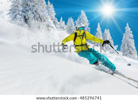 Skier skiing downhill in high mountains #485296741