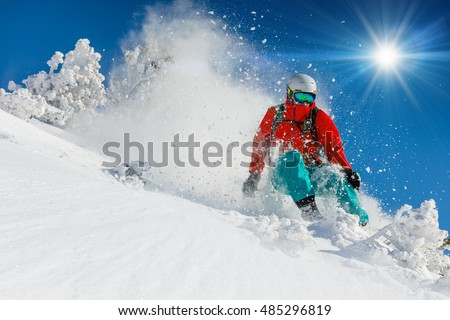 Skier skiing downhill in high mountains #485296819