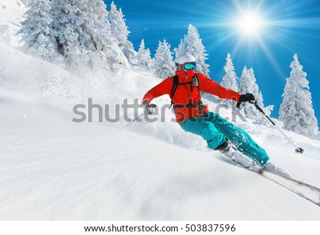 Skier skiing downhill in high mountains #503837596