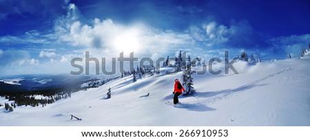 Skier skiing downhill in high mountains against sunset,Dragobrat,Ukraine #266910953