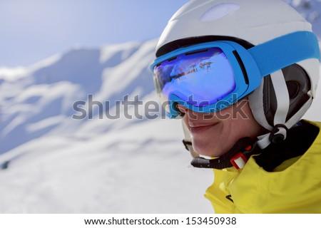 Skier, skiing, winter sport - portrait of beautiful female skier