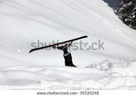 skier, who is lost in masses of snow