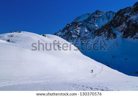 Skier winter trail mountain valley snow, Starolesna valley, High Tatra Mountains, Slovakia