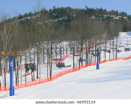 Skiers are going up the chair lift