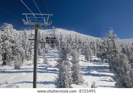 Skiers are riding lift on a very cold day at one of the Lake Tahoe ski resorts (Sierra Nevada, USA).