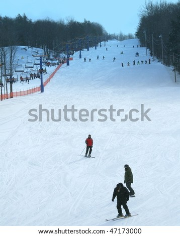 Skiers going downhill on skiis