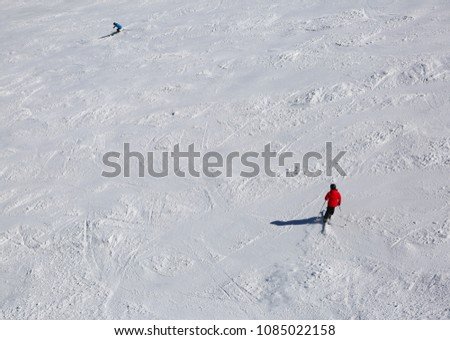 skiers in the slope with snow #1085022158