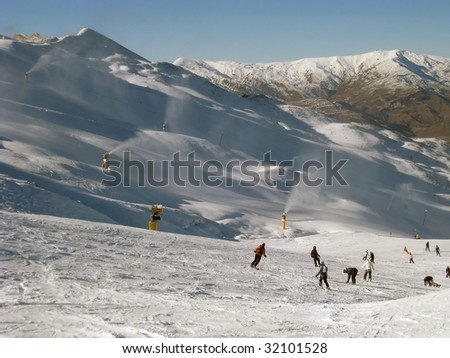 Skiers on New Zealand's Coronet Peak in Queenstown