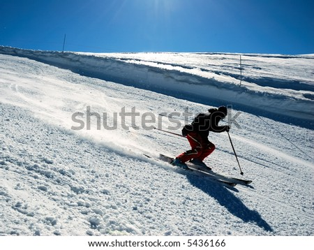 Skiers on slope racing down the hill. Horizontal orientation. - stock photo