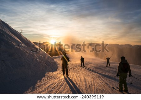 Skiers on the piste at dusk, Les Arcs, Bourg Saint Maurice, Savoie, France