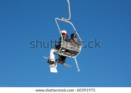 Skiers on the ski lift (Amden, Switzerland)