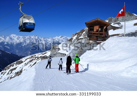 Free photos Skiers on the ski slope in Swiss Alps in sunny day ...