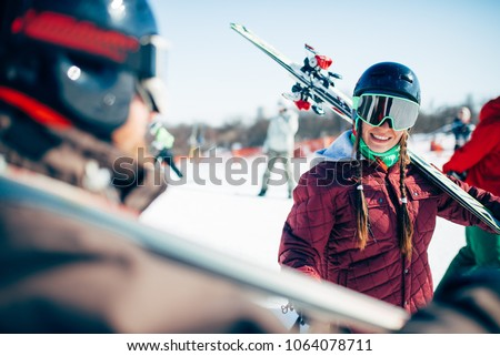 Skiers with skis and poles, extreme lifestyle #1064078711