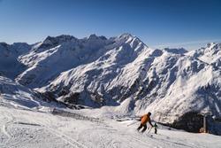 Skiier on slopes in the ski resort of St. Anton, Austria - December 2019 - beautiful snowy peaks - winter sports in Austria